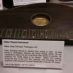 musical instrument display with informational plaque