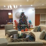 Lobby decorated for the Christmas season & business center in background