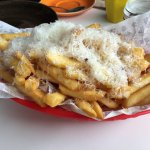 Fries cooked with truffle oil and served with shaved cheese