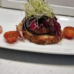 Herb Crusted Pork On a Crostini with red cabbage and a homemade apple sauce.