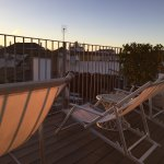 Lounge chairs on rooftop deck