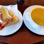 Lunch of brie/cranberry panini and curried chicken soup