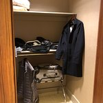 Ample closet but with no high bar to hang coats.