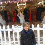 Our grandson with the amazing singing reindeer's