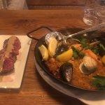 Paella Mariscos (right); Hanger Steak (left)