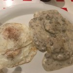 Sausage Gravy & Biscuits with kind of over-easy eggs.