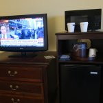 There is a nice TV. mini fridge and microwave.