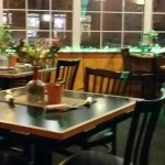 Seating is at tables or booths