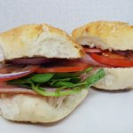 Gammon Ham, Tomatoe, Red Onion and Watercress, in a tiger roll.