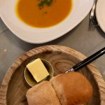 Pumpkin and butternut squash soup with fresh bread.