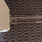 photo showing age & rust of door track to closet in bedroom