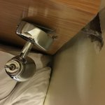 Lamp did not work and was hanging of the headboard