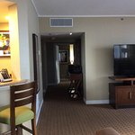 From living room, w kitchen on left, leading to bedrooms. There are no washer/dryers in suites .