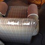 armchair frayed around the edges