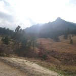 Looking at the Flatirons from the start of the trails