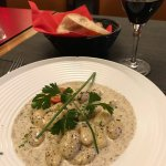 Gnocci in cream sauce with grated black truffle. A beautifully realized appetizer.