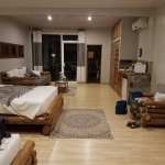 spacious room with small kitchenette and patio