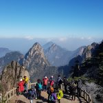 A winter scene of the blue sky and mountains at a viewing platform up on Huangshan Mountain.