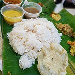 Curry and rice on a banana leaf