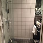 Bathroom with semi circular plexiglass shower door........not as daunting or scary as it looks!!