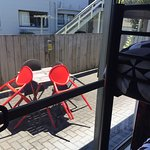 Outside seating area with the Kitchenette Rooms