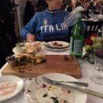 Nice appropriate sweatshirt in an nice Italian Restaurant