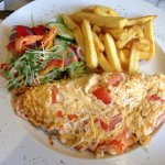 Delicious Omelette , chips and side salad.
