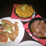 Paella, chicken strips with spicy salsa and chorizo sausage