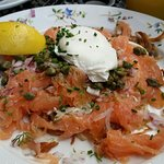 Smoked salmon over frittas w/farm fresh poached egg, capers & onions - OMTASTY!!