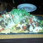 Short Rib Beef Nachos. Enough for 4-6 people at least. One of the best nacho plates I have ever