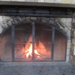 outdoor fireplace near ice rink