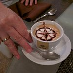 Cappuccino art, and happy customers!