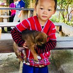 Little guy from the village with his puppy