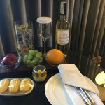 Complimentary fruits, pastries and wine