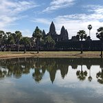 Iconic photo across small lake from Angkor Wat