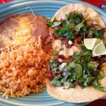 Taco lunch special with rice and beans
