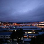 The Harbour at night with Cruise ship to the right, and the bridge centre right in the backgroun