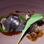 Roasted lamb saddle (milk fed), black winter truffles, Jerusalem artichoke, and rocket