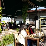 Customers enjoy warm sun with breakfast