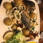 Seafood grill sea bass salmon tiger prawn and squid