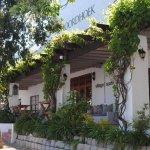 De Noordhoek Hotel entrance opening onto village life in Noordhoek