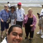 On the beach the VIRGIN with tourists of the cruise Island Princess