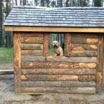 play log house with wooden play area