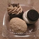 peanut butter chocolate cupcake, cookies and cream cupcake, and a cookie