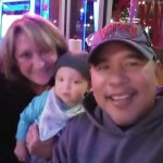 Me and grandma (my wife) with our grandson at Coach's