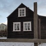 one of the wooden sided houses