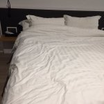Unmade bed and stains on sheets