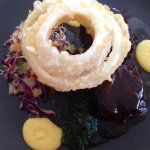 Beef brisket with Texan slaw, puree and tempura onion rings