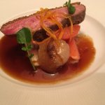 Pan-roasted Pekin duck breast with cipollini onions and essence of orange.