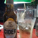 Pear cider under library desk lamps